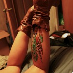 Down leg colored tattoo