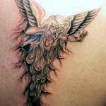 Evil angel tattoo