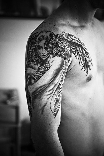 beautiful angel tattoo on sholder