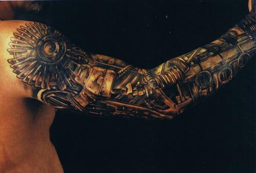 Full arm steampunk tattoo