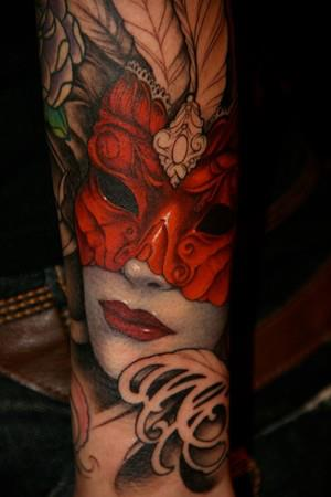Half sleeve tattoo of girl with mask and red lips