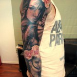 Portrait sleeve tattoo on blossoms