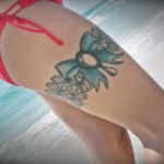 garter tattoo with blue