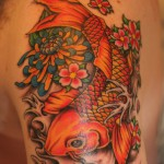 Small koi fish tattoo