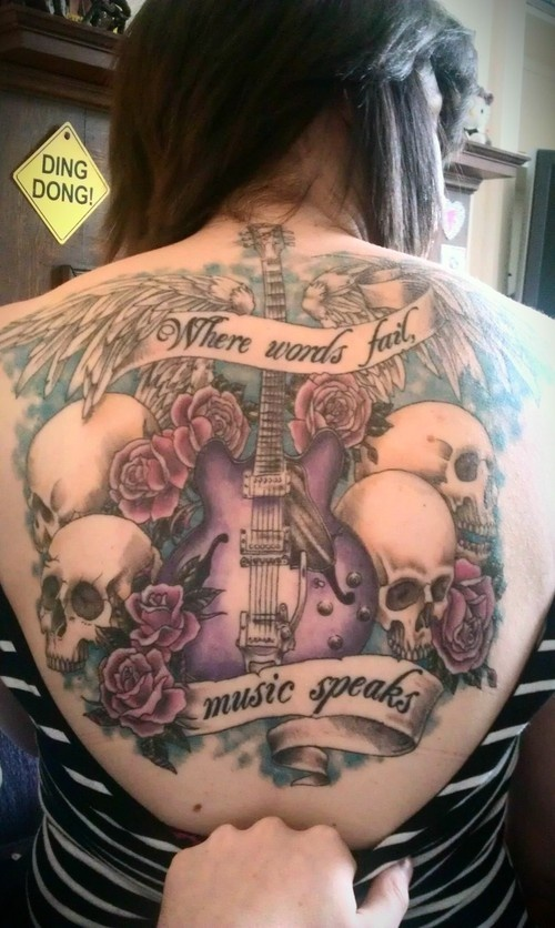 Guitar skull tattoo