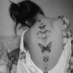 Spine butterfly tattoo