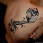 Owl tattoo in cute style