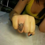 Owl tattoo on finger