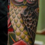 Owl tattoo on full sleeve