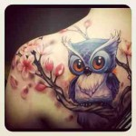 Tattoo with owl and cherry blossom