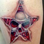 Star and skull tattoo