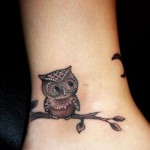 Tiny and sweet owl tattoo