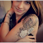 Dreamcatcher tattoo on upper arm