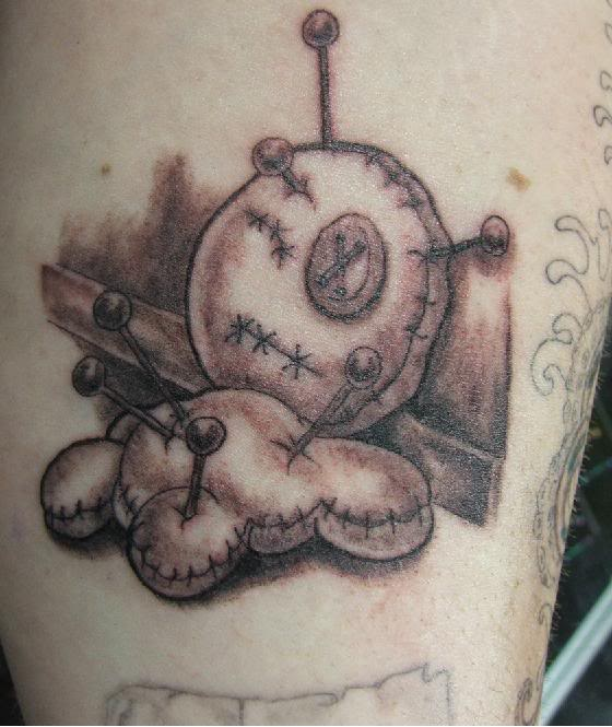 sad voodoo doll tattoo - Design of TattoosDesign of Tattoos