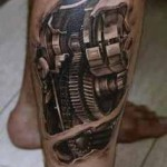 biomechanical tattoo design on leg
