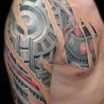 biomechanical tattoo on chest and arm