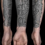 biomechanical tatto on forearm