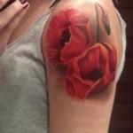 poppy tattoo on shoulder