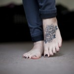black rose tattoo design on feet