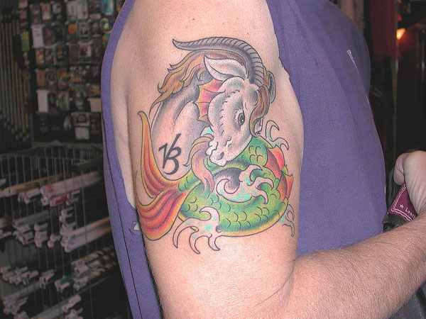 colorful capricorn tattoo