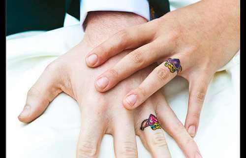 colorful wedding ring tattoo Design of TattoosDesign of Tattoos