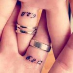 wedding ring tattoo design with date