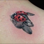 flying ladybug tattoo