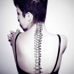 realistic spine tattoo design
