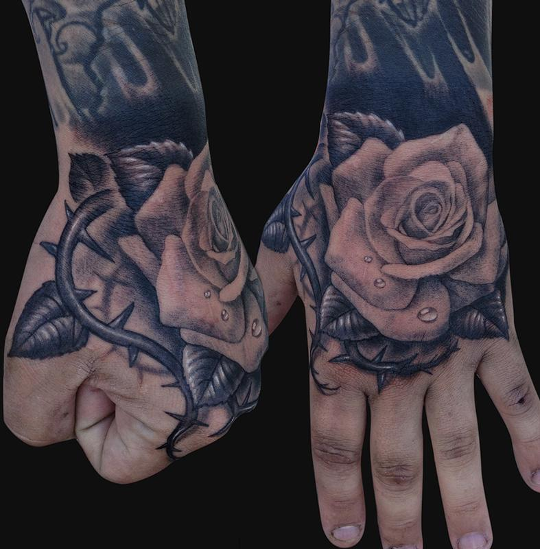 hand rose tattoo design