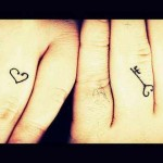 key and heart wedding ring tattoo design