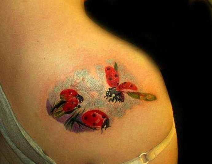 ladybug tattoo on shoulder