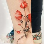 poppy tattoo on leg