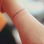arm minimalist tattoo