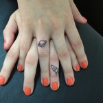 minimalist tattoo design on fingers