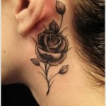 black rose tattoo on neck
