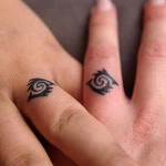patterned wedding ring tattoo design