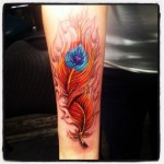 phoenic feather tattoo design on arm
