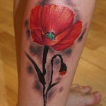 poppy tattoo design on leg