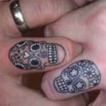skull and flowers wedding ring tattoo design