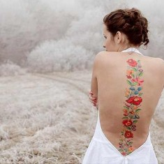 colorful spine tattoo design