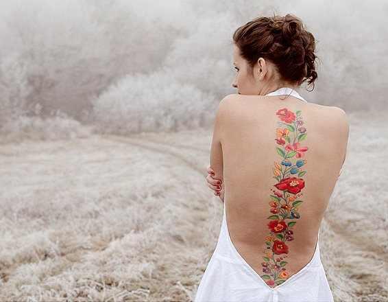 colorful spine tattoo design