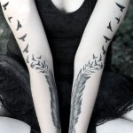 symmetrical feather tattoo design