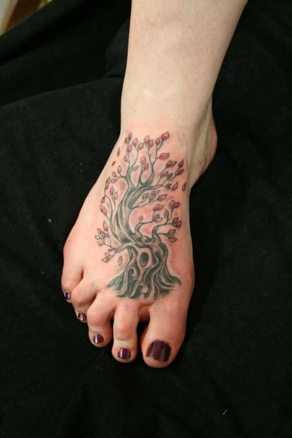 tree of life tattoo design on foot