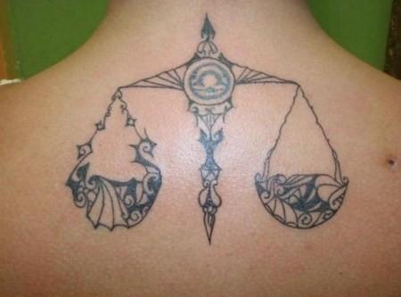 tribal libra tattoo on back