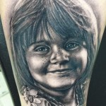 Andy Engel black ink portrait tattoo