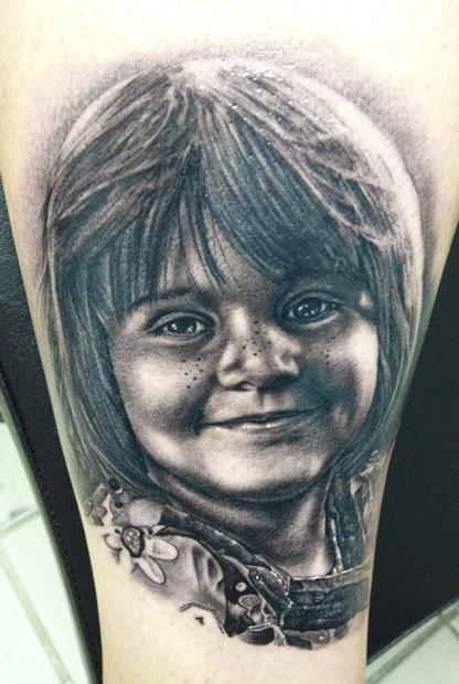 Andy Engel black ink portrait tattoo