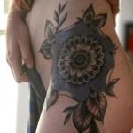 Alice Carrier blue flower tattoo