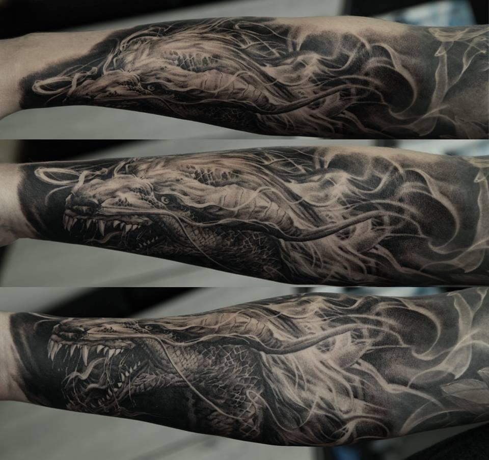Dmitriy Samohin dragon full sleeve tattoo