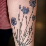 Alice Carrier flower tattoo