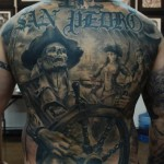 Carlos Torres full back skull tattoo